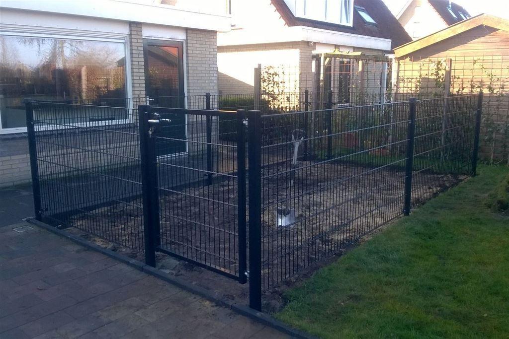 Afrastering of omheining tuin voor de hond